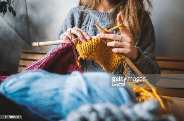 close up on woman's hands knitting - cardigan sweater stock pictures, royalty-free photos & images