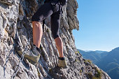 Close Up on women leg while climbs equipped rocky wall