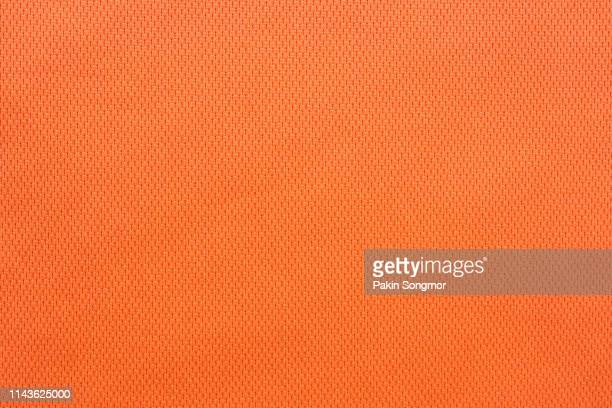 close up orange colour fabric texture. textile background. - orange background stock pictures, royalty-free photos & images