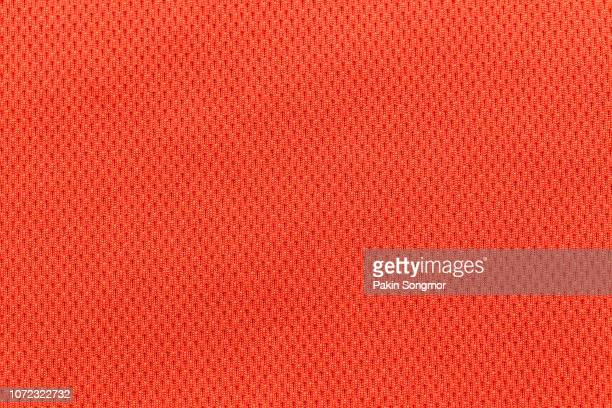 close up orange or red fabric texture. textile background. - crochet stock pictures, royalty-free photos & images