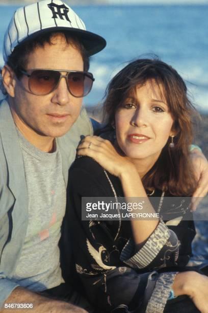 Close up Paul Simon et Carrie Fisher le 20 septembre 1983 en France