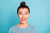 Close up photo beautiful amazing she her lady look side empty space licking tongue upper lip crazy silly mischief carefree mood giggling wear casual sweater pullover isolated blue bright background