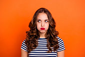 Close up photo beautiful she her lady red lipstick hold breath full mouth air ignore not listen speak talk tell look up wear casual striped white blue t-shirt clothes isolated orange bright background