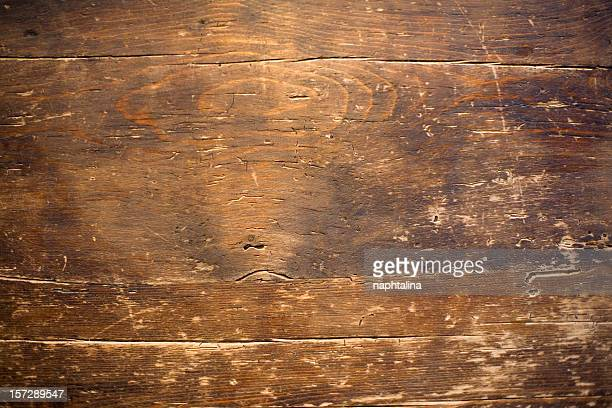 Close up photo of a distressed wood table