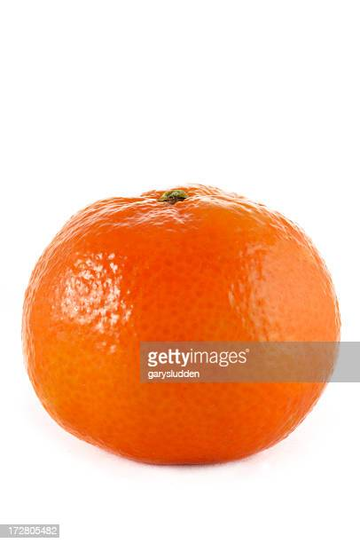 Close up photo of a shiny tangerine on a white background