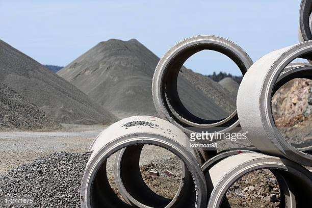 Close up photo of cement tubes used in road construction