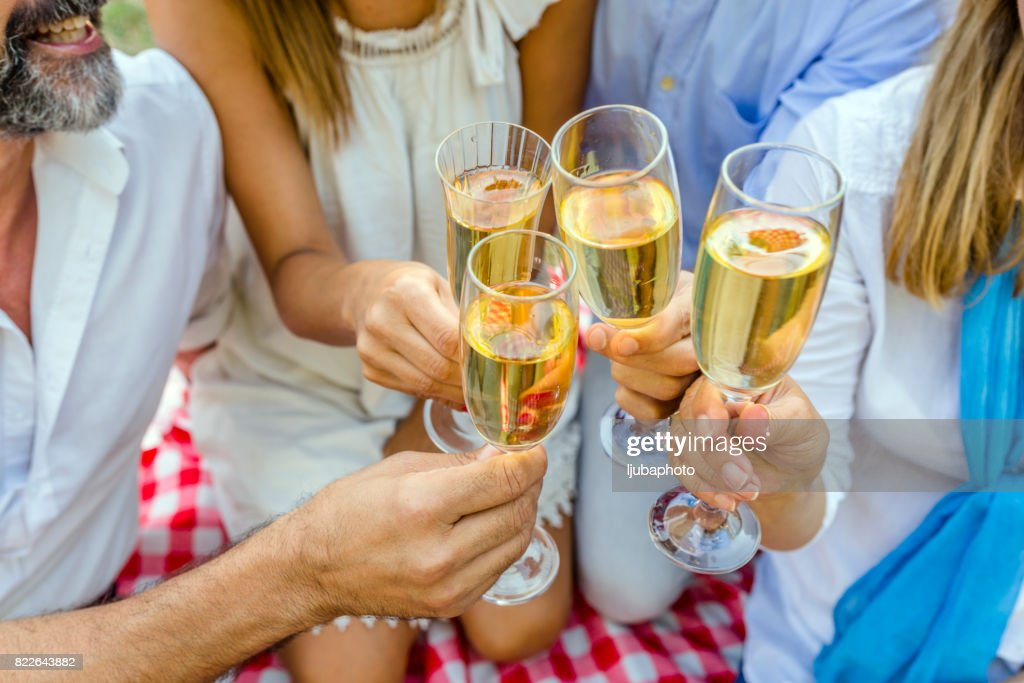 Close up photo of Happy friends with glasses of champagne : Stock Photo