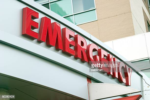 Close up photo of red large letters spelling emergency