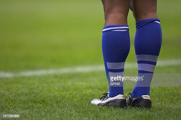 close up photo of rugby player's blue socks and white shoes - rugby league stock pictures, royalty-free photos & images
