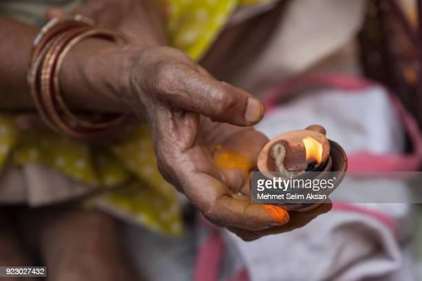 close up photo of senior hindu woman praying - wishful skin stock pictures, royalty-free photos & images