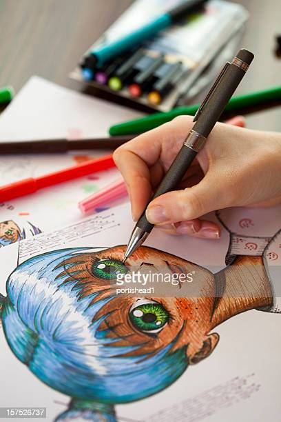 close up photo of the work of a manga painter - anime stock photos and pictures