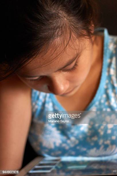 close up photo of young teen using touch screen tablet - capital region stock pictures, royalty-free photos & images
