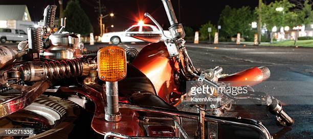 close up photograph of a crashed motorcycle and police car - crash stock pictures, royalty-free photos & images
