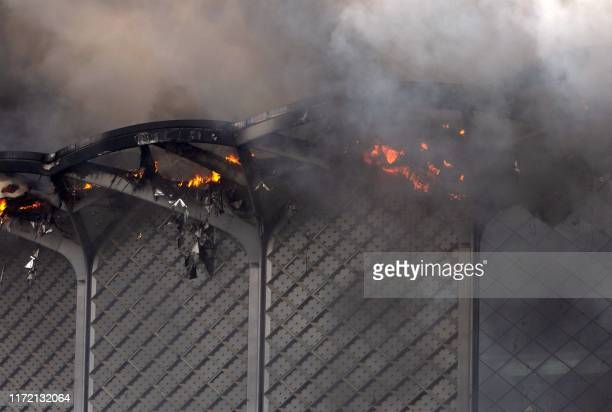 A close up picture shows flames engulfing a section of the Haramain highspeed train station building in Saudi Arabia's western city of Jeddah on...
