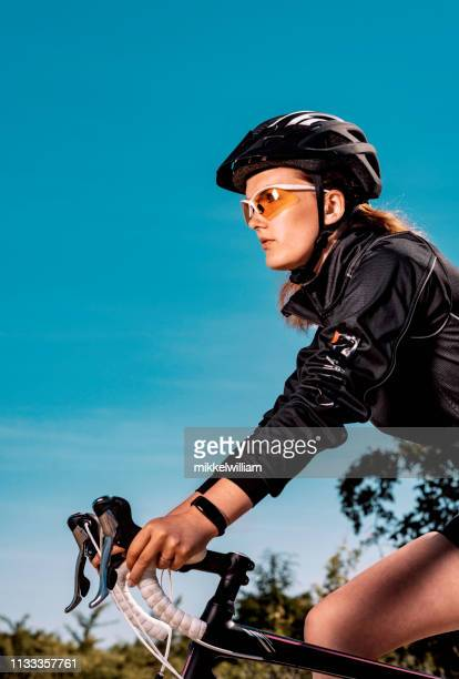 Close up portrait athlete with cycling helmet who rides racing bicycle