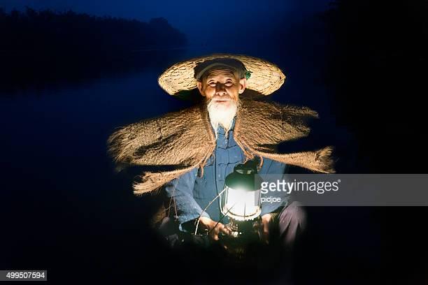 Close up Portrait Chinese traditional fisherman, Li River China
