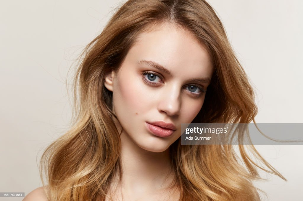 close up portrait of a beautiful long haired woman : Stock Photo
