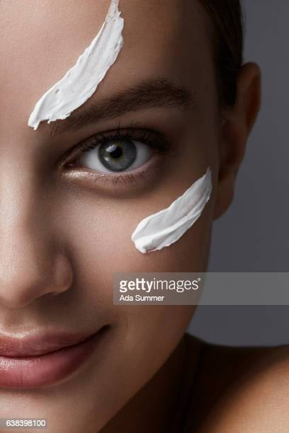 Close up Portrait of a beautiful woman with cream smear on her cheek