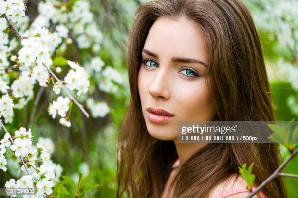 Close Up Portrait Of A Beautiful Young Girl On The Background Of
