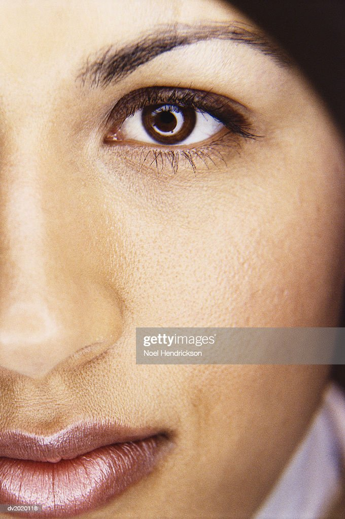 Close Up Portrait of a Brown Eyed Women : Stock Photo