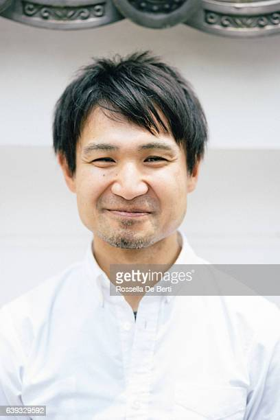 Close up portrait of a cheerful Japanese man