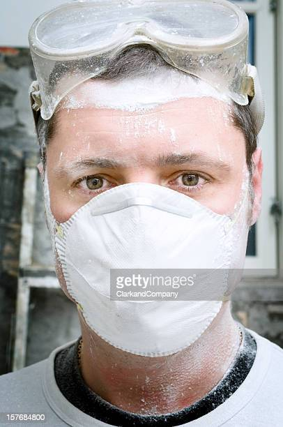 Close Up Portrait Of A Construction Worker Wearing Protective Mask