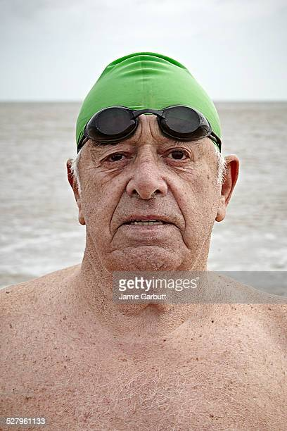 A close up portrait of a elderly male swimmer