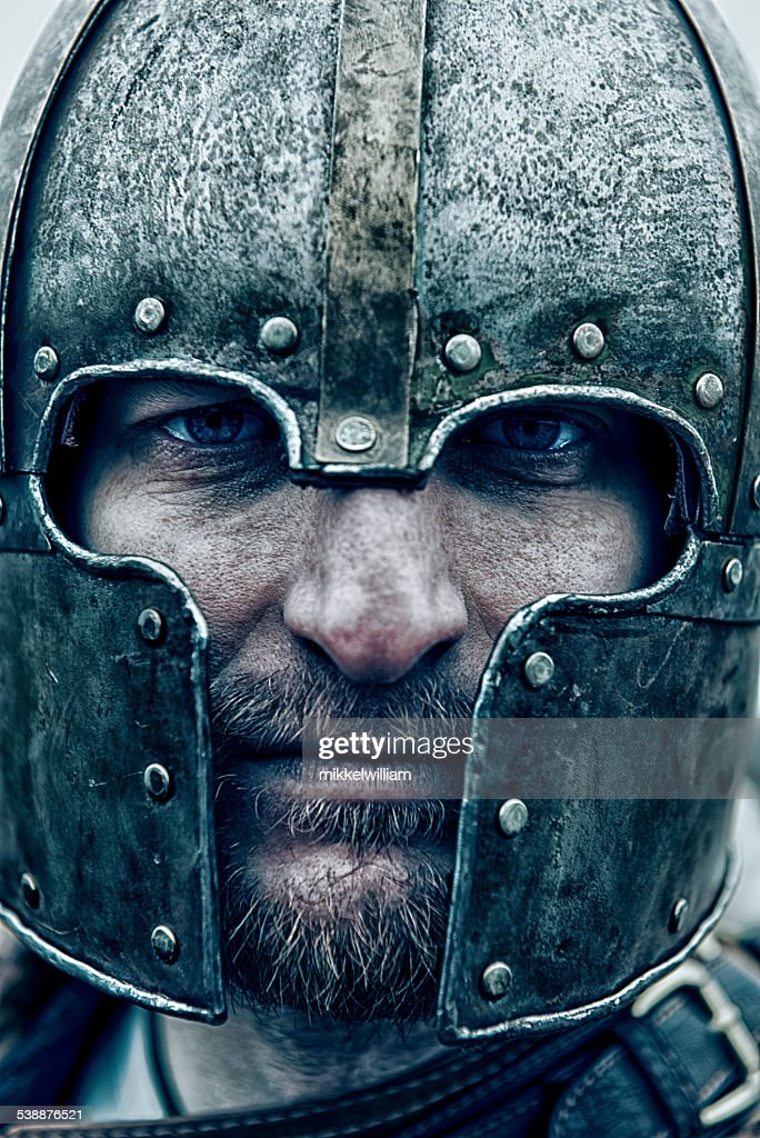 Close up portrait of a knight wearing a helmet : Stock Photo