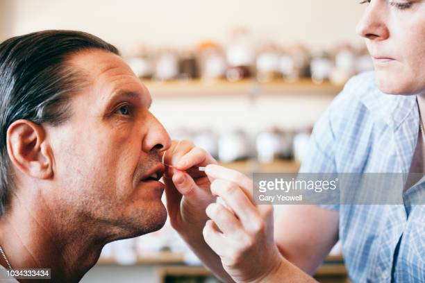 close up portrait of a man having acupuncture on his face - acupuncture needle stock pictures, royalty-free photos & images
