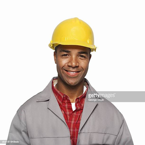close up portrait of a man wearing a hard hat