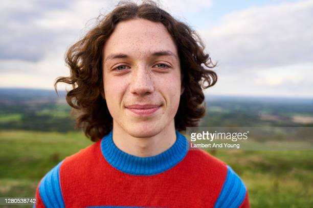 close up portrait of a teenager looking to the camera in the outdoors - portrait stock pictures, royalty-free photos & images