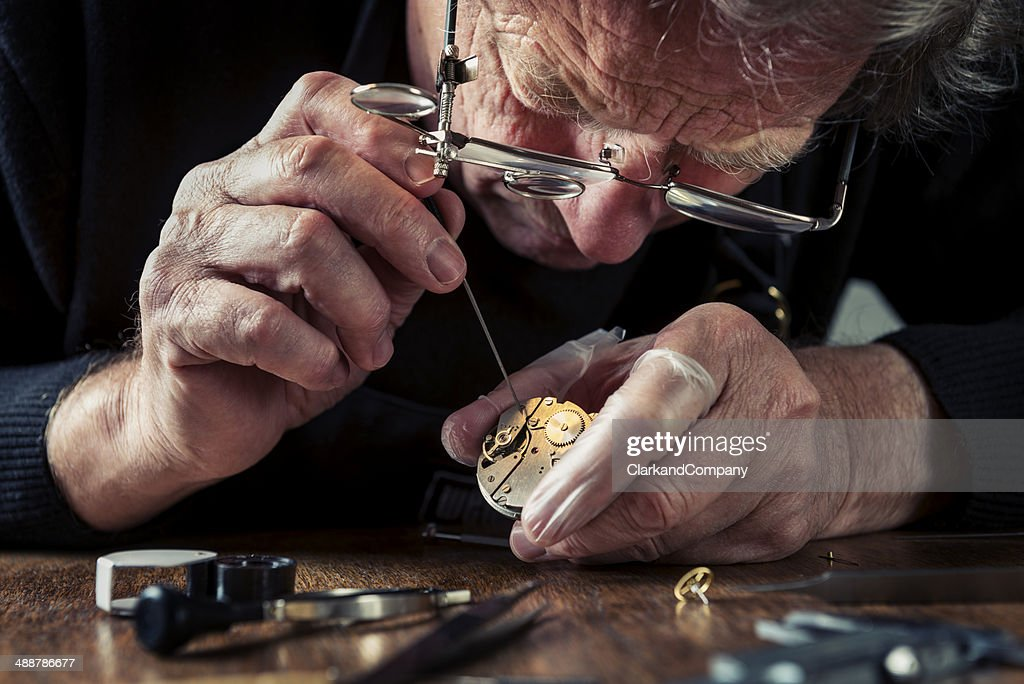 Close Up Portrait of a Watchmaker at Work : Stock Photo
