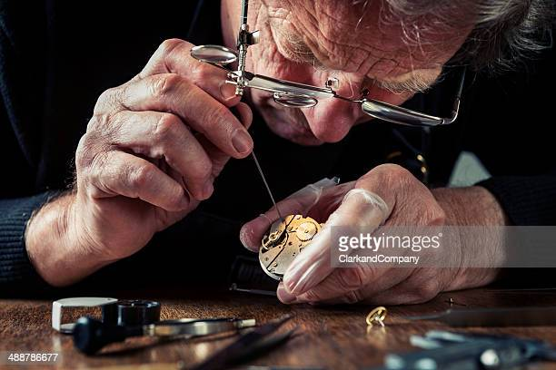 close up portrait of a watchmaker at work - craftsman stock photos and pictures