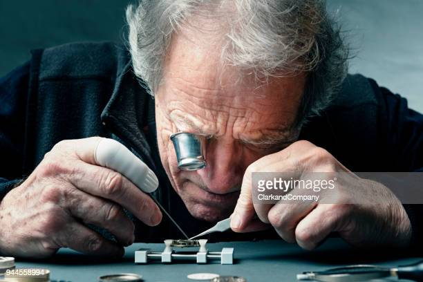 close up portrait of a watchmaker at work - watch timepiece stock pictures, royalty-free photos & images