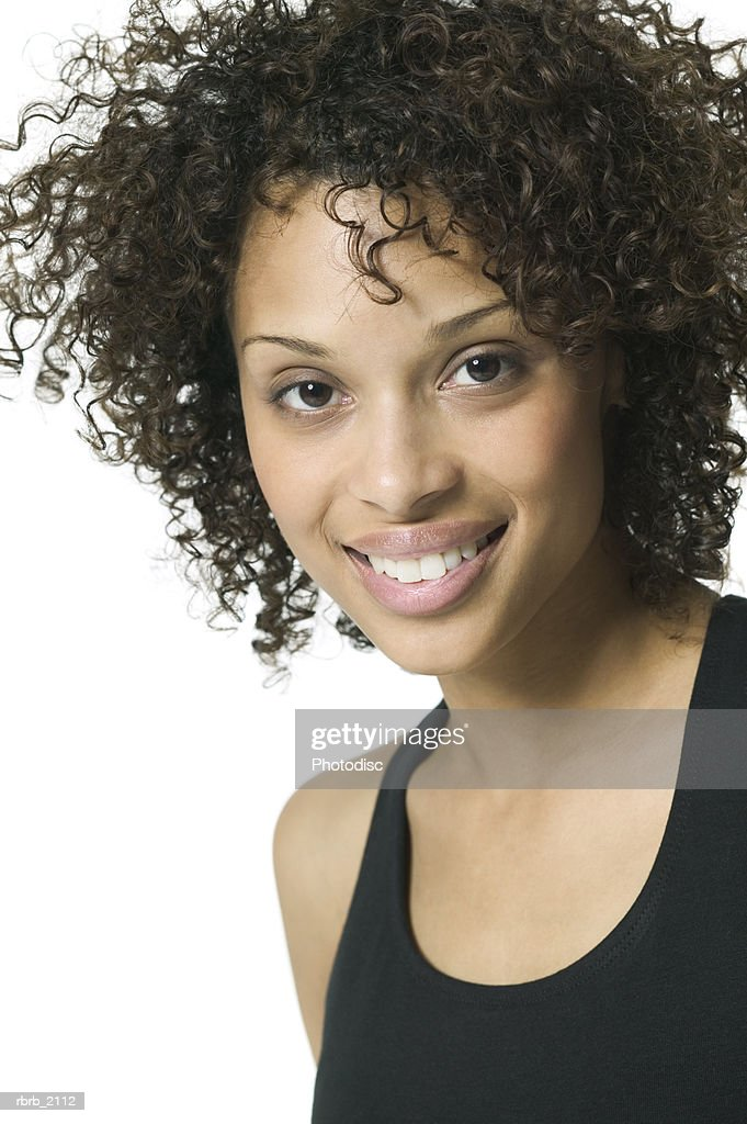 close up portrait of a young adult woman in a black tank top as she smiles : Photo