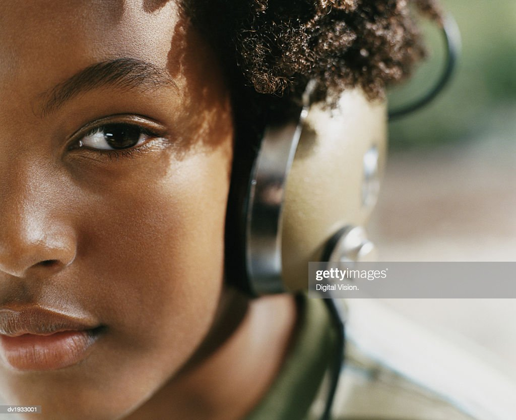 Close Up Portrait of a Young Woman Wearing Headphones : Stock Photo