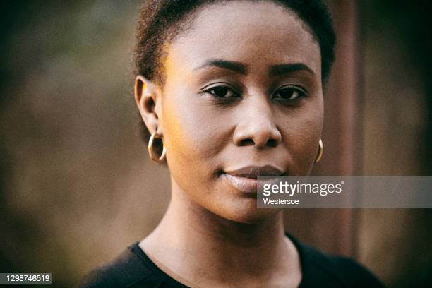 close up portrait of african woman - human head stock pictures, royalty-free photos & images
