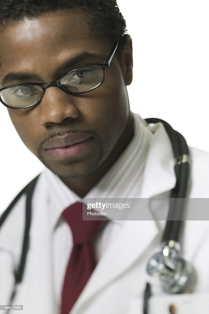 close up portrait of an adult male doctor in a tie and white coat : Foto de stock