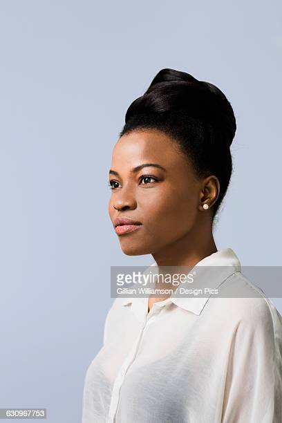 Close up portrait of an African Canadian woman against blue wall