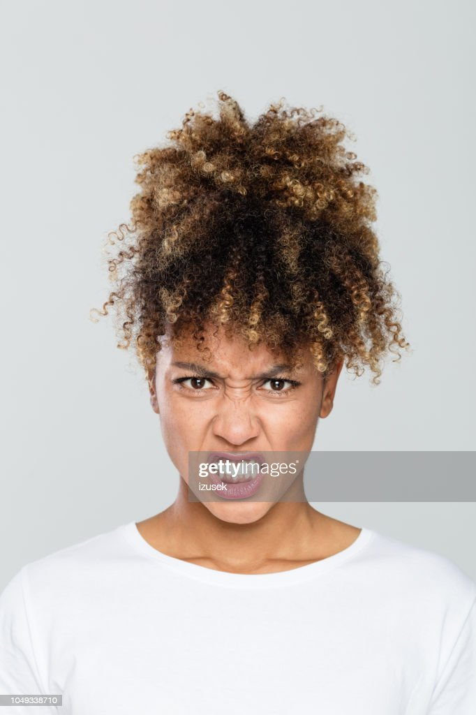 0ecf74ff36a Close Up Portrait Of Angry Afro American Woman Stock Photo - Getty ...