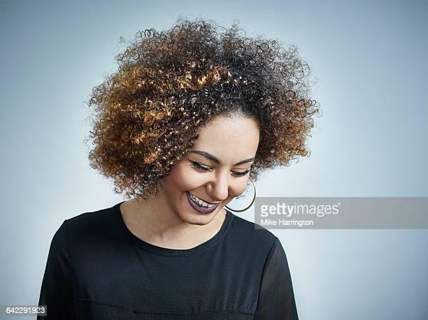 close up portrait of black female looking down - blick nach unten stock-fotos und bilder