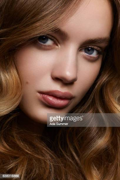 close up portrait of brunette with wavy hair