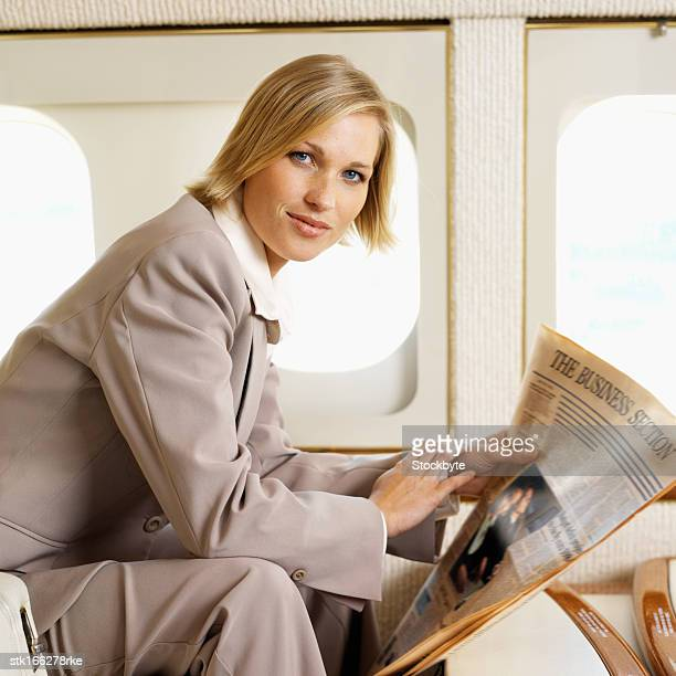 close up portrait of businesswoman holding newspaper