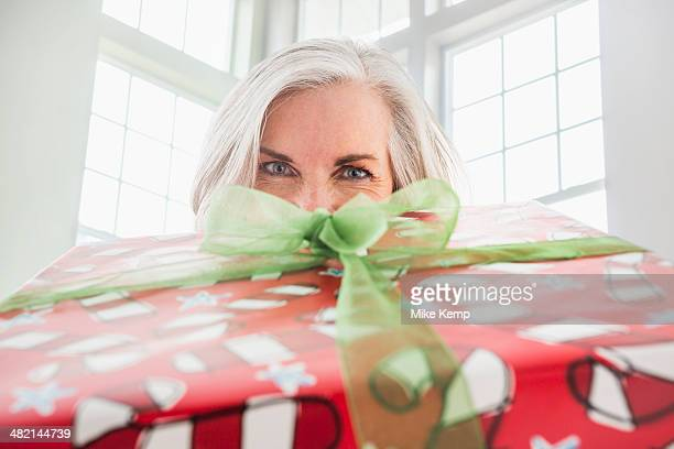 Close up portrait of Caucasian woman with Christmas gift