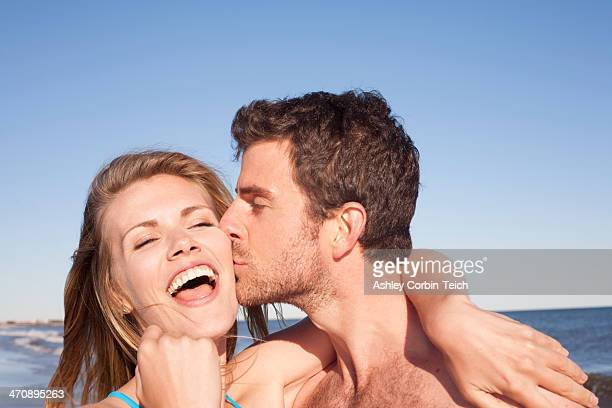 Close up portrait of couple on beach, Breezy Point, Queens, New York, USA