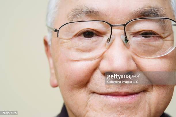 Close up portrait of elderly man wearing glasses