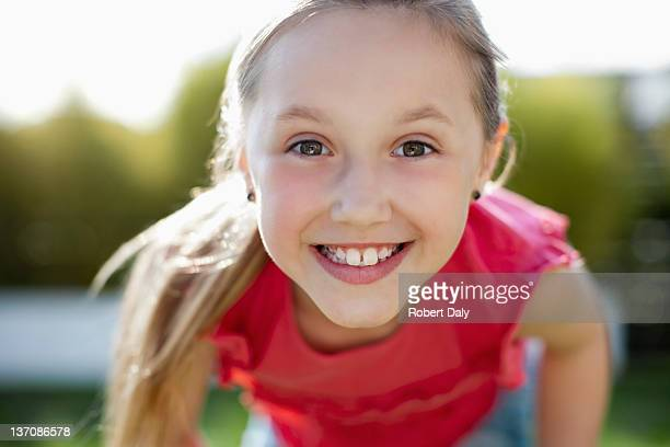 Close up portrait of girl with toothy smile