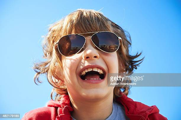 Close up portrait of happy young boy in sunglasses