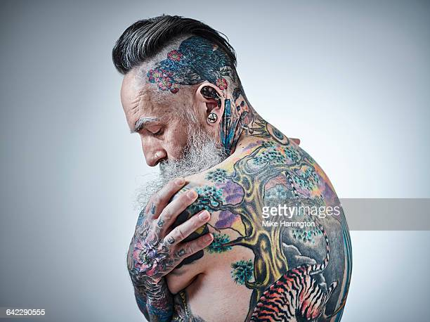 Close up portrait of heavily tattooed male