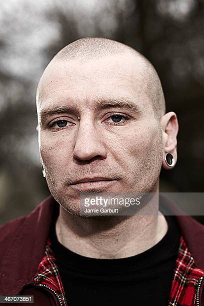 close up portrait of male skinhead - skinhead stock photos and pictures